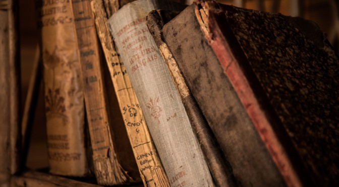 Image of old books on a shelf