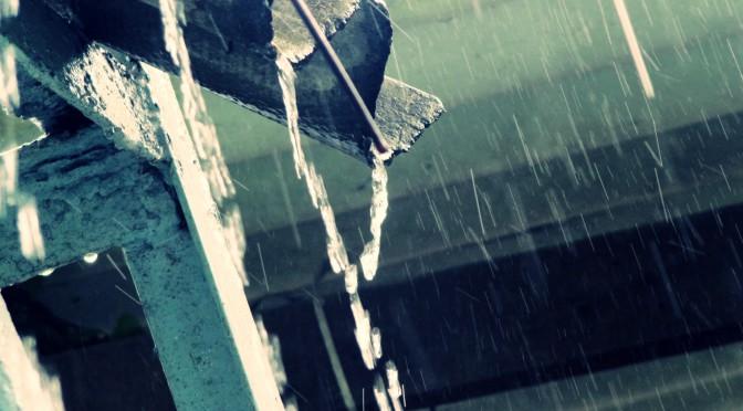 Image of rain falling off roof
