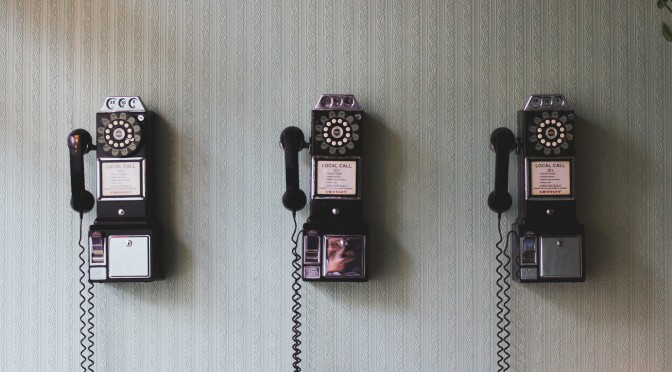 Image of three wall mounted pay phones